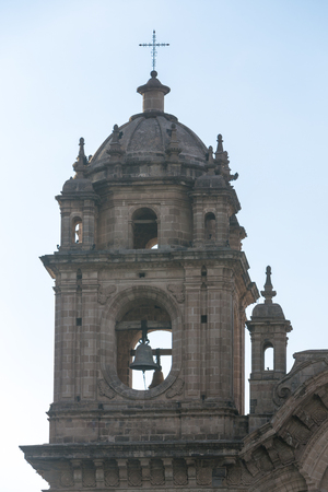 Tower of the historic Iglesia de la Compania in Cusco. Peru. The church dates back to 1571 and sits on top of an old Inca Palace. Editorial