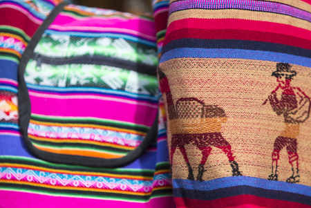 artisanry: Handmade colored woolen bag for sale at the tourist craft market in Cusco. Peru (Selective focus) Stock Photo