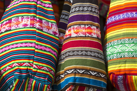 artisanry: Handmade colored woolen bag for sale at the tourist craft market in Cusco. Peru