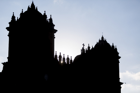 Silhouette of twin towers and dome of the historic Iglesia de la Compania in Cusco. Peru. The church dates back to 1571 and sits on top of an old Inca Palace. Editorial