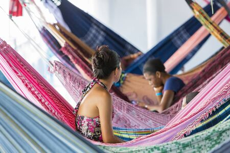 diamante: People resting in hammocks passenger boat deck is going down the Amazon river entre LeticiaTabatinga and Manaus. Amazonas State. Brazil 2015