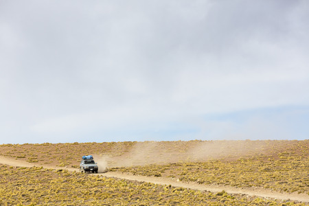 avaroa: Off-road vehicle driving in the Atacama desert, with blue sky in Bolivia Eduardo Avaroa Andean Fauna National Reserve, Bolivia 2014