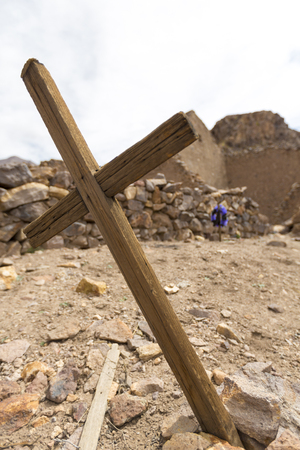decaying: Details of wooden old christian religious cross on tumb in abandoned and decaying church in San Antonio ghost village at the footstep of San Antonio volcano in the Bolivian altiplano. Stock Photo