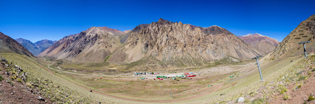 aconcagua: Panorama of mountain scenic view with ski lift and sky resort against a clear blue sky during the summer near the Aconcagua National Park. Mendoza, Argentina