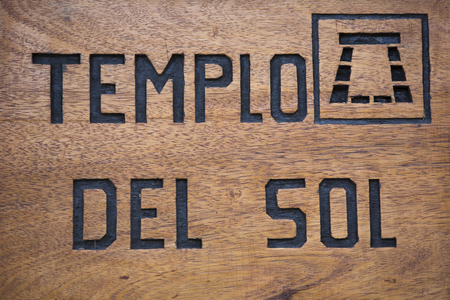inca ruins: Closeup on wooden sign with Templo Del Sol Temple of the Sun written in Spanish at the Pisac Inca Ruins near Cusco. Peru 2015 Stock Photo