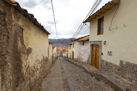 peru architecture: Narrow street alley in Cusco, Peru with Incan stonework and colonial architecture. Peru 2015 Stock Photo