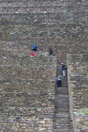 inca ruins: Group of tourists walking on the ancient stairway at Ollantaytambo Inca Ruins. Peru 2015