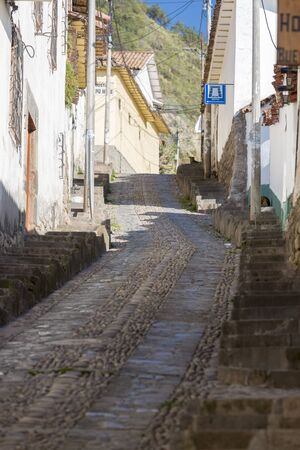 incan: Narrow steep street alley in Cusco, Peru with Incan stonework and colonial architecture. Peru 2015