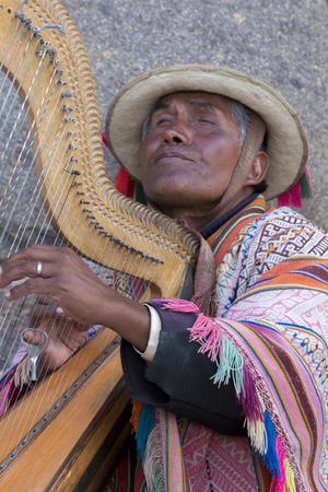 blind man: Peruvian blind man with traditional clothes playing harp in the street of Cusco, Peru 2015