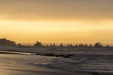 manora: Panorama of the harbor of Manora during a wonderful orange sunset. Peru 2015