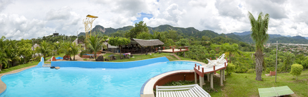 amazon rain forest: Panorama of swimming pool with tropical mountains in the background in Rurrenabaque, the gateway to the Bolivian Amazon rain forest. Bolivia 2015