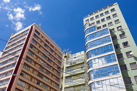 privileged: Modern residential buildings in La Paz against a blue sky. Bolivia 2015