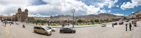 Panorama of Cusco hand Square Plaza de Armas with the Inca Statue in front of the Iglesia de la Compania with tourists in Cusco, Peru 2015 Editorial