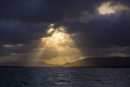 ocean and sea: Ocean with a golden sunset shining through the clouds in Margarita Island, Venezuela