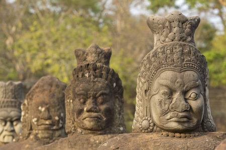 cambodia sculpture: Sculpture of faces at the entrance of Bayon Temple, Angkor Wat, Cambodia 2016