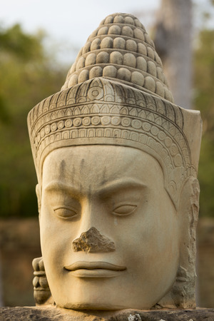 cambodia sculpture: Sculpture of face at the entrance of Bayon Temple, Angkor Wat, Cambodia 2016 Stock Photo