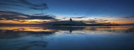 panoramic view: Panoramic view of amazing blue orange sunset with still ocean on Gili Air Island, Lombok. Indonesia
