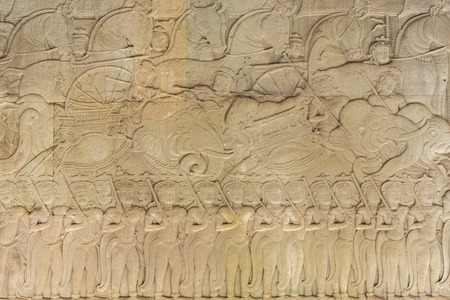 prasat bayon: Wall Carving at Prasat Bayon Temple In Angkor Thom. Angkor Wat Complex. Scene Of Marching Army, Khmer Culture. Famous Landmark. Tourism. Ornament Background. Stock Photo