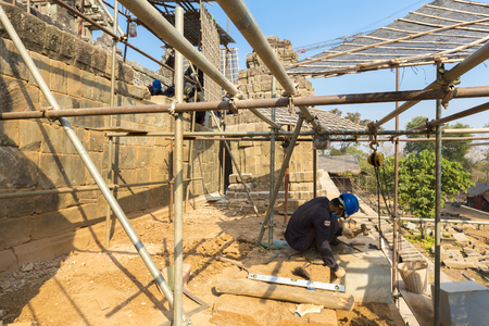 restoring: Cambodian workers restoring the Phnom Bakheng temple in Angkor. Editorial