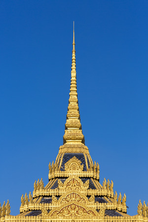 phnom penh: Details of the roof from the Royal Palace in Phnom Penh with clear blue sky. Khmer architecture Cambodia