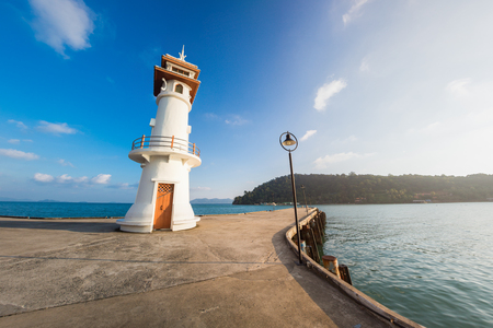 bao: Bang Bao lighthouse and the pier with clear blue sky in Koh Chang island. Thailand