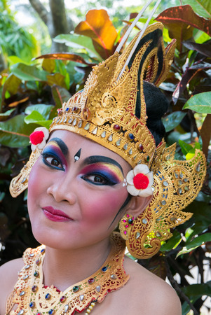 udeng: Portrait of beautiful young woman Indonesian During the preparation for New Year Balinese religious ceremony in Bali (Nyepi). Indonesia 2016