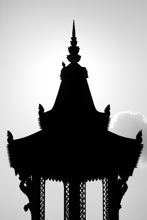 phnom penh: Silhouette of Khmer roof temple with clouds in the background. Phnom Penh, Cambodia. Black and white