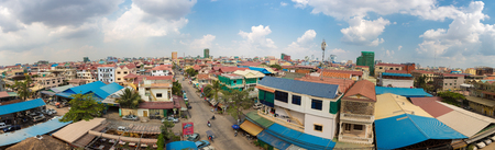 overpopulated: PHNOM PENH, CAMBODIA - JANUARY 29: Aerial panorama of residential district in the city of Phnom Penh during the day with colored houses. Cambodia 2016