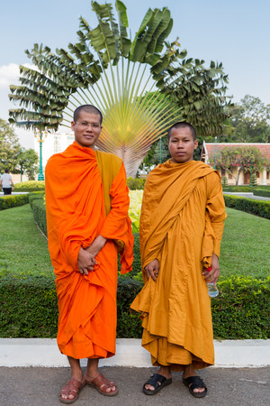 phnom penh: Two young Cambodian Buddhist monks posing in the Kings palace garden in Phnom Penh. Cambodia 2016