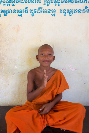 phnom penh: Young Cambodian Buddhist monk sitting and learning Buddhims in a monastery. Phnom Penh. Cambodia 2016