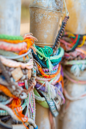 penh: Colored bracelets dedicated to the victims of the killing fields of Choeung Ek in Phnom Penh, Cambodia. Selective focus