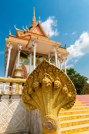 penh: Details of colored Khmer temple, part of a monastery near Phnom Penh. Khmer architecture Cambodia