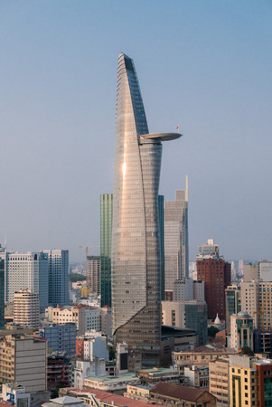 highriser: The Ho Chi Minh Citys tallest building Bitexco Financial Tower against a clear blue sky in Vietnam. 2016