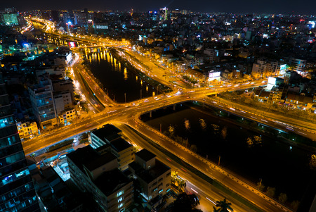 trails of lights: Aerial view on Ho Chi Minh city with street lights and trails of car lights, Saigon, Vietnam 2016 Stock Photo
