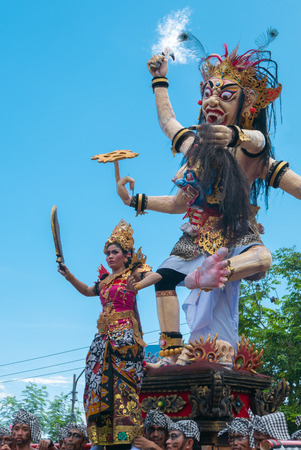 negara: Giant sculpture Balinese musicians and dancers in action During the New Year Nyepi religious ceremony in the street of Negara - Bali, Indonesia in 2016