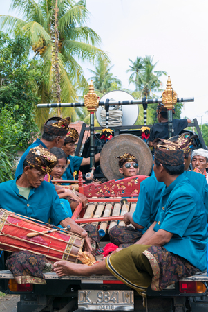 negara: Group of senior Indonesian musicians playing music in the back of a lorry During the New Year Nyepi religious ceremony in the street of Negara - Bali, Indonesia in 2016