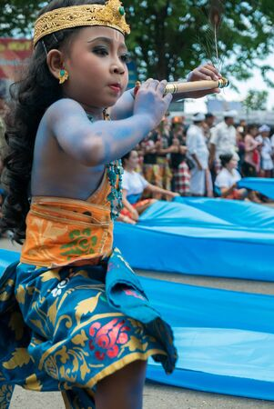 negara: Young Balinese boy playing flute During Nyepi New Year. A Balinese religious ceremony in the street of Negara, Indonesia 2016 Editorial