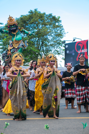 negara: Balinese woman with traditional dress dancing During the New Year Nyepi religious ceremony in the street of Negara - Bali, Indonesia in 2016 Editorial