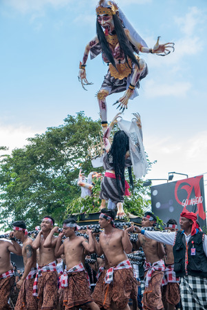 negara: Group of young Indonesian men holding a giant sculpture Balinese New Year Nyepi During the religious ceremony in the street of Negara - Bali, Indonesia in 2016 Editorial