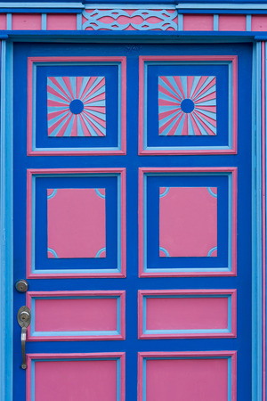 balcony window: Details of colorful blue and pink window and balcony in traditional colonial Salento white house. Colombia. Stock Photo