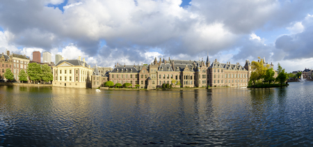 ministry: The Hague (Den Haag) skyline panorama with Mauritshuis Museum, Binnenhof palace (Dutch Parliament), and modern skyscrapers reflected in the Hofvijver canal, The Netherlands.