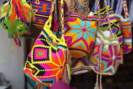 Women fashion accessories, Various items of crocheted bucket-style handbags, Wayuu handcrafted mochilas woolen bags, Colombia - street market / Fashion - Crochet handbags Standard-Bild