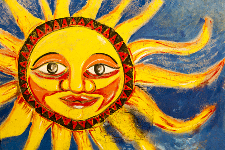 marta: Close up on colorful abstract sun painted on a wall in Santa Marta, Colombia 2015