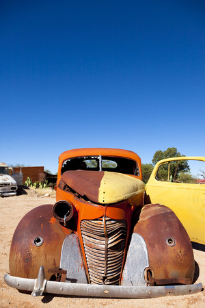 solitaire: Abandoned colorful vintage cars in Solitaire, a lonely settlement 80km north of Sesriem in the Khomas Region near the Namib-Naukluft National Park, Namibia