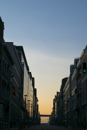 supposed: Rue de la Loi in Brussels with no car and no people in the street with sunset light. This street is supposed to be the busiest of brussels at this time of the day.