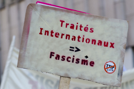 activist: Activist signs DURING THE GAME OVER TTIP demonstration in Brussels. A call for action live on Free Trade Agreements Such As TTIP and CETA TISA. Belgium 2016