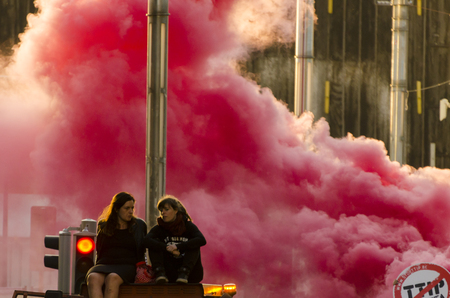 live action: Smoke and activists During the TTIP GAME OVER demonstration in Brussels. A call for action live on Free Trade Agreements Such As TTIP and CETA TISA. Belgium 2016