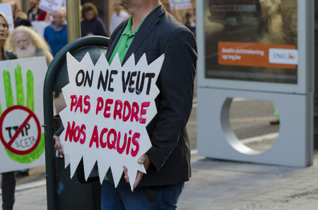 live action: Activists and signs DURING THE GAME OVER TTIP demonstration in Brussels. A call for action live on Free Trade Agreements Such As TTIP and CETA TISA. Belgium 2016