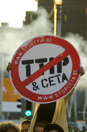 Activists and signs DURING THE GAME OVER TTIP demonstration in Brussels. A call for action live on Free Trade Agreements Such As TTIP and CETA TISA. Belgium 2016