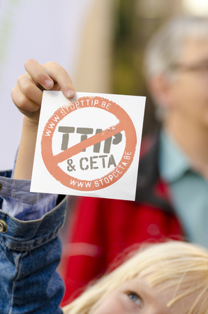 live action: Official TTIP GAME OVER logo helg by kids hand During a demonstration in Brussels. A call for action live on Free Trade Agreements Such As TTIP and CETA TISA. Belgium 2016 Editorial